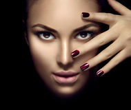 Fashion model girl face, beauty woman makeup and manicure. Over dark background Royalty Free Stock Photo