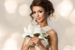 Fashion  Model Girl with Flowers. Royalty Free Stock Photos