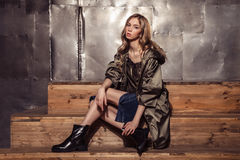 Fashion Model girl full length portrait in the brown coat. High Royalty Free Stock Image
