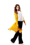 Fashion Model girl full length portrait isolated on white background. Beauty stylish brunette woman posing in. Yellow cardigan, white shirt, black pants in royalty free stock images