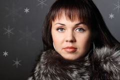 Fashion model girl in fur on the dark background Royalty Free Stock Photo