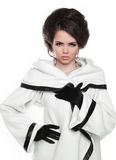 Fashion model girl with hairstyle in white coat isolated on whit stock image