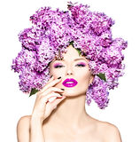 Fashion model girl with lilac flowers hairstyle Stock Images