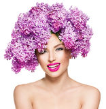 Fashion model girl with lilac flowers hairstyle Stock Image