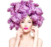 Fashion model girl with lilac flowers hairstyle Stock Photo