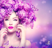 Fashion model girl with lilac flowers hairstyle royalty free stock photography
