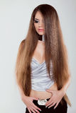 Fashion model girl with long healthy hair posing at studio Royalty Free Stock Photos