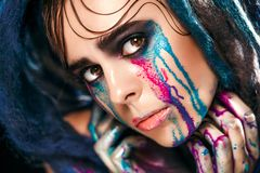 Fashion model girl portrait with colorful paint make up. woman bright color makeup. Closeup of vogue style lady face, Art des Royalty Free Stock Photos