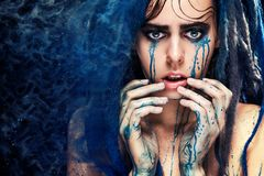 Fashion model girl portrait with colorful paint make up. woman bright color makeup. Closeup of vogue style lady face, Art des Stock Photography