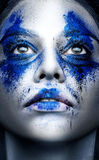 Fashion model girl portrait with colorful powder make up. Beauty. Woman with bright blue makeup and white skin.  Abstract fantasy make-up, art design Stock Photo