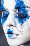 Fashion model girl portrait with colorful powder make up. woman with bright blue makeup and white skin. Abstract fantasy. Fashion model girl portrait with Royalty Free Stock Photos