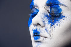 Fashion model girl portrait with colorful powder make up. woman with bright blue makeup and white skin. Abstract fantasy. Fashion model girl portrait with Royalty Free Stock Image