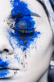 Fashion model girl portrait with colorful powder make up. woman with bright blue makeup and white skin. Abstract fantasy Royalty Free Stock Photos