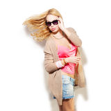 Fashion model girl portrait dressed in pink top, cardigan, denim Royalty Free Stock Photography