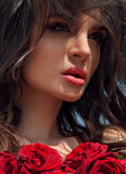 Fashion Model Girl Portrait with Red Roses. Beauty Fashion Model Girl Portrait with Red Roses Stock Photography