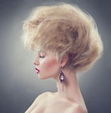 Fashion model girl with updo hairstyle Royalty Free Stock Photos
