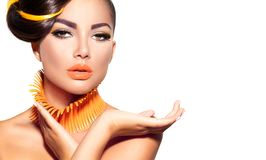 Fashion model girl with yellow and orange makeup Royalty Free Stock Photo
