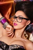 Fashion model in glasses with birght makeup Stock Photo