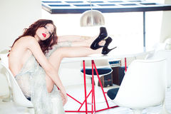 Fashion model in glittering dress Royalty Free Stock Photos