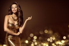 Fashion Model Gold Dress, Elegant Young Woman in Golden Gown. Luxury Lady Beauty Portrait royalty free stock images