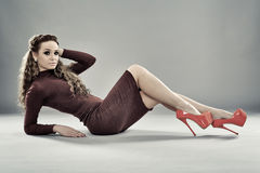 Fashion model on gray background, full length Stock Photography