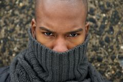 Fashion model with gray winter scarf covering face Stock Photos