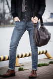 Fashion model guy with bag outdoors Royalty Free Stock Photography