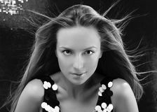 Fashion model with hair blowing in wind. Close-up portrait royalty free stock image