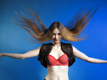 Fashion model with hair blowing in the wind Royalty Free Stock Images