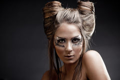 Fashion model with halloween makeup and hairstyle. On black studio background royalty free stock photos