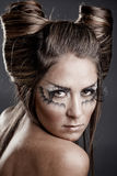 Fashion model with halloween makeup and hairstyle. On gray studio background stock photos