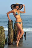 Fashion model in the hat and blue bikini. Bathing suit Royalty Free Stock Photos