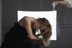 Fashion Model Having Hair Sprayed At Photo Shoot Stock Images