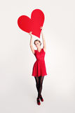 Fashion Model holding Big Red Heart Royalty Free Stock Photos