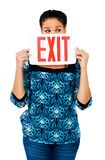 Fashion model holding exit sign Royalty Free Stock Photography