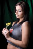Fashion model - holding flower. Twenty something fashion model looking at the dry flower she's holding Stock Photo