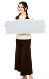 Fashion model holding placard Royalty Free Stock Image