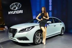 A Fashion Model on HYUNDAI Sonata saloon car. Guangzhou, China - November 21, 2015: A fashion model was on HYUNDAI Sonata saloon car in the 13th China (Guangzhou royalty free stock photography