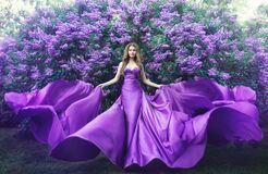 Free Fashion Model In Lilac Flowers, Young Woman In Beautiful Long Dress Waving On Wind, Outdoor Beauty Portrait In Blooming Garden Royalty Free Stock Photos - 191608268
