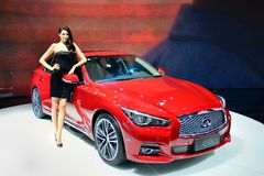 Fashion Model on Infiniti Q50L saloon car Royalty Free Stock Photos