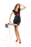 Fashion model iron clothes Stock Photography