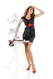 Fashion model iron clothes Royalty Free Stock Photos