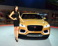 Fashion Model on Jaguar C-X17 concept SUV Royalty Free Stock Photos