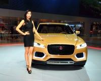 Fashion Model on Jaguar C-X17 concept SUV Royalty Free Stock Photos