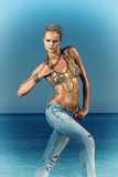 Fashion model in jeans by the sea Stock Photo