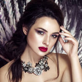 Fashion model with jewelry, modern make up. Royalty Free Stock Photo