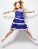 Fashion model jumps in studio Stock Photo