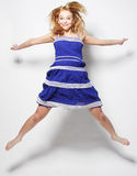 Fashion model jumps in studio Royalty Free Stock Image