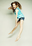 Fashion model jumps in studio Royalty Free Stock Photography