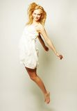 Fashion model jumps in studio Stock Images